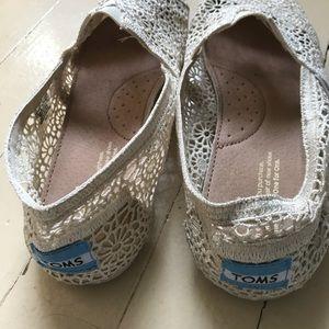 Cream crotchet slip-on Toms shoes